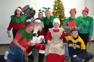 Photo of group with Santa & Mrs. Claus